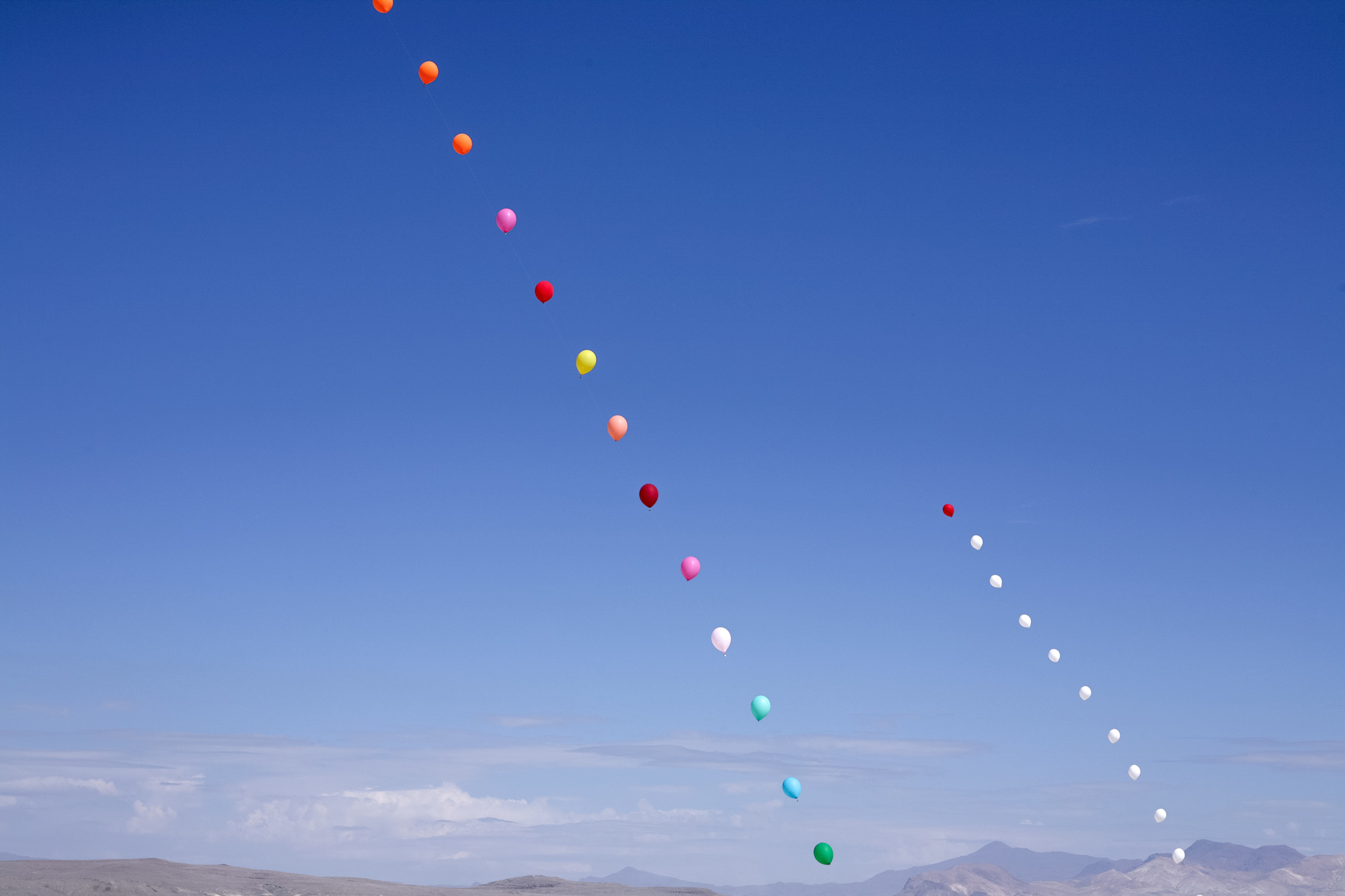 balloons in the air, with bells